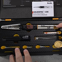 A Person Pointing at SOLDERPRO 120K Professional Butane Soldering Iron Kit